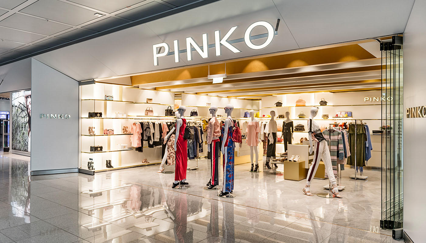 31f2c303d56 Like all Pinko shops, the flagship store at Munich Airport targets the  fashion-conscious modern woman looking for styles to accentuate her beauty  on any ...