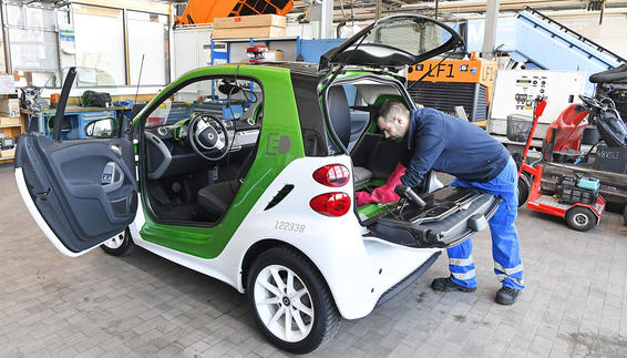 Mechanic engineer is working on an E-Car