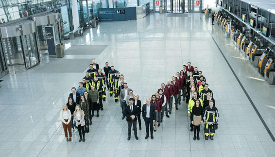 Employees of Munich Airport positioned as an M.